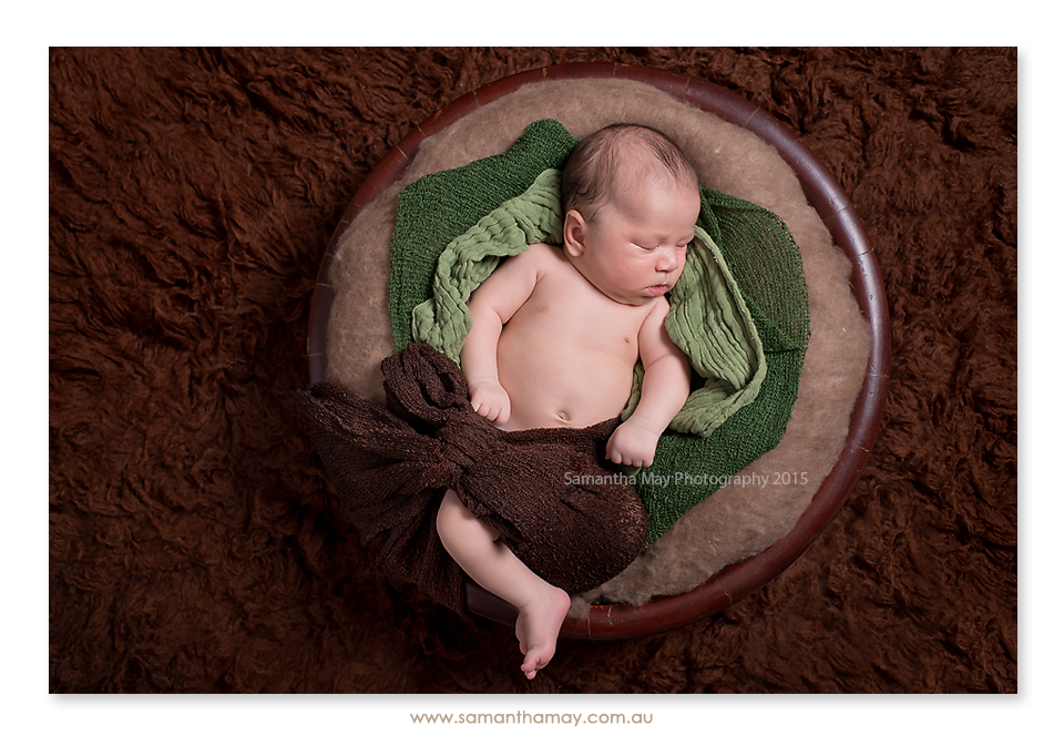 perth newborn on back in bowl with wrap