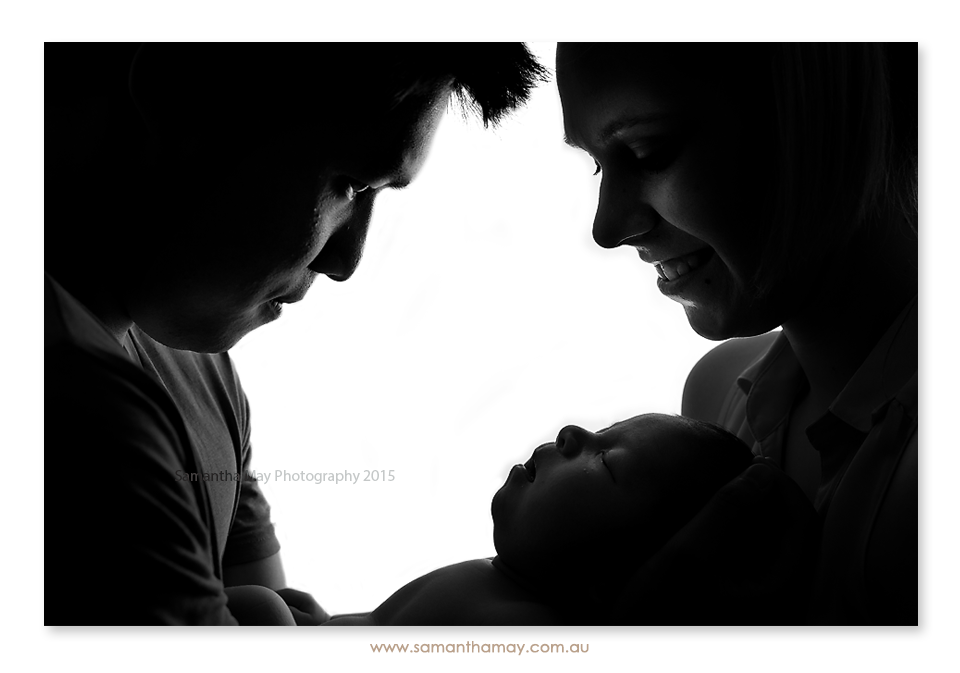 newborn with family black and white silhouette