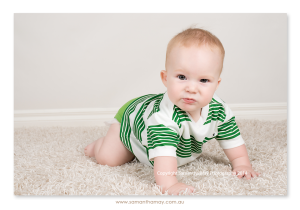 six month boy on knees funny face