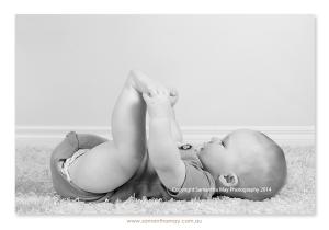 baby boy grabbing his feet