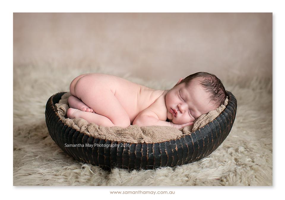 newborn on tummy in bowl perth