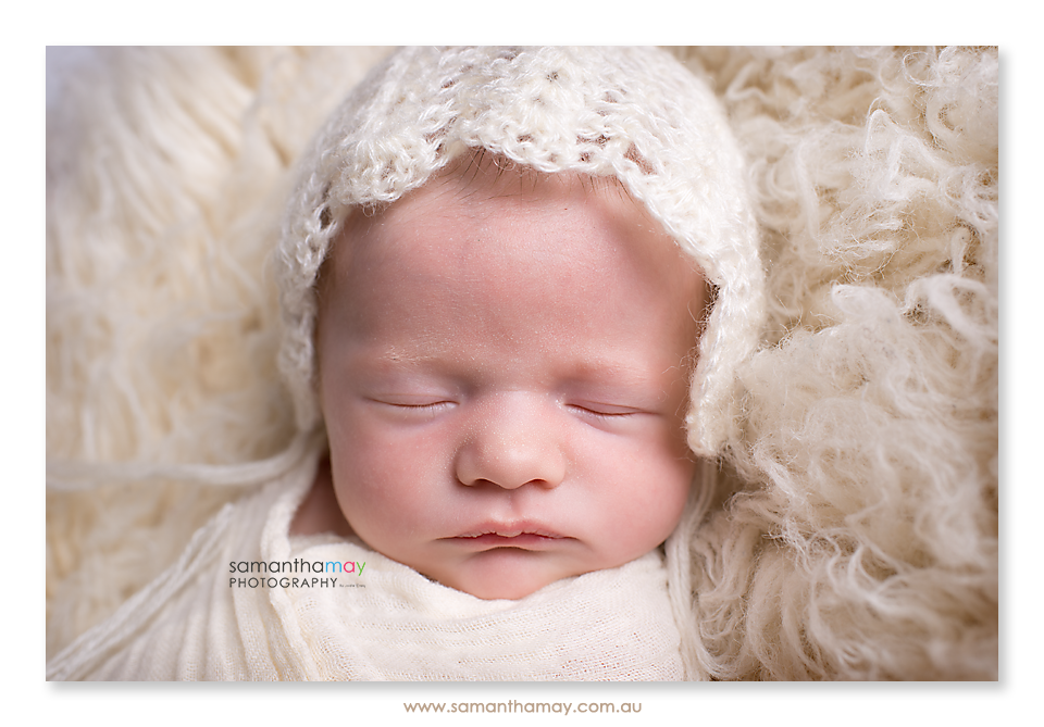 baby girl in cream bonnet