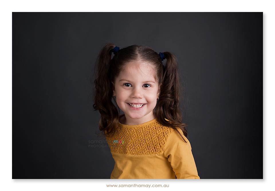 Smiling little girl dressed Zara for Kids