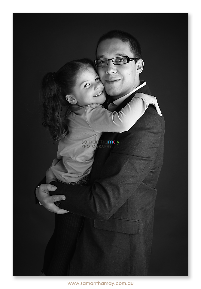 portrait of girl and her daddy hugging
