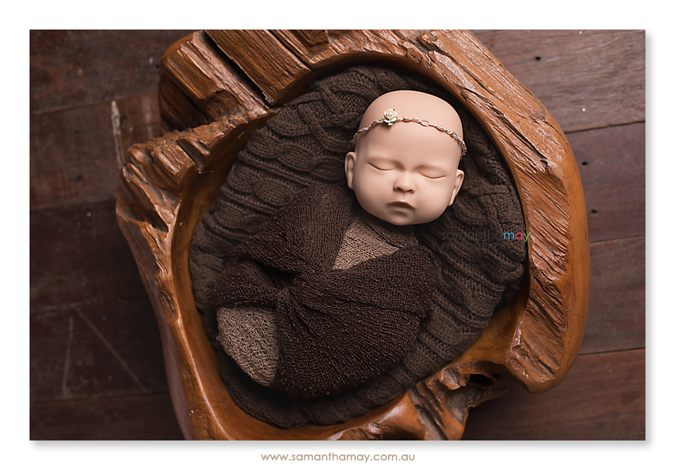 standinbaby wrapped in wooden bowl