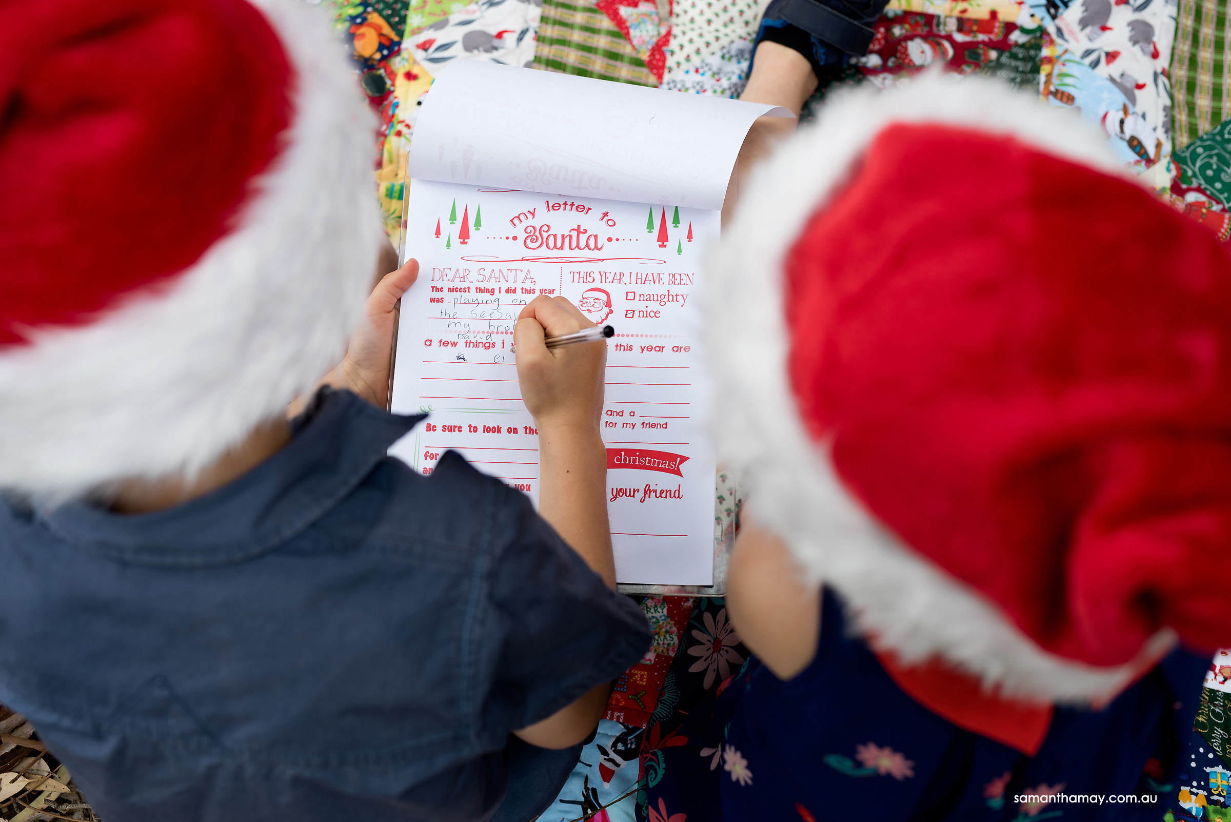 two children writing a later to santa