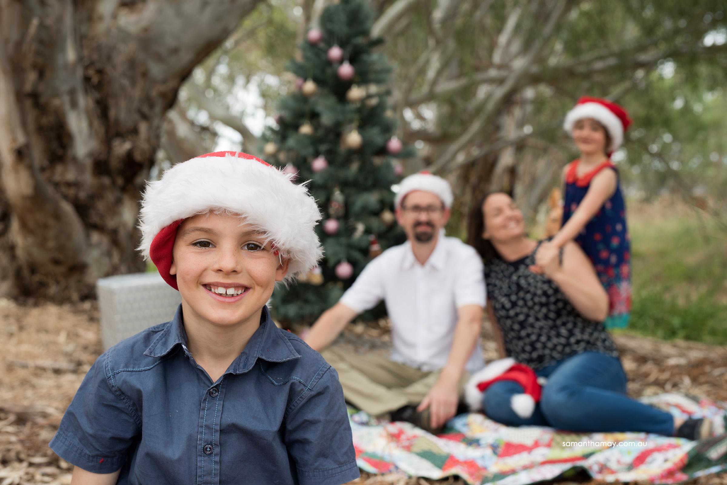 little boy at christmas in Aussie bush