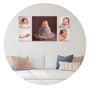 newborn baby in set of 5 canvas collage hanging above couch